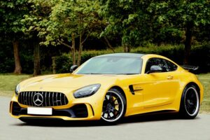 yellow-lhd-mercedes-benz-beside-trees-2365572