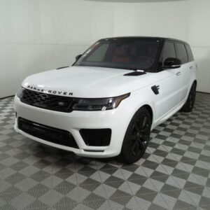 white left hand drive range rover parked outside an amersham home